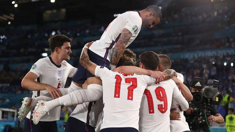 The England players celebrate Kane's goal. Pic: AP