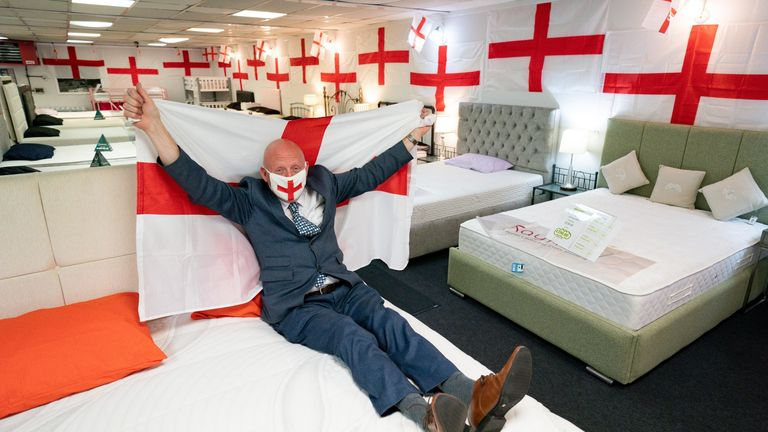 Noel Barton in his store VIP Beds in Birmingham, which he has covered in around 400 England flags