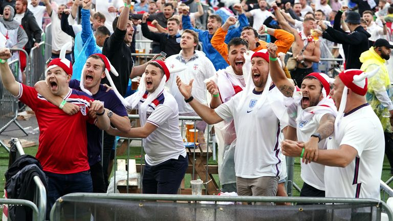 ngland fans in Manchester celebrate as Harry Kane scores his side's first goal, during the Euro 2020 quarter final match between England and Ukraine. Picture date: Saturday July 3, 2021.