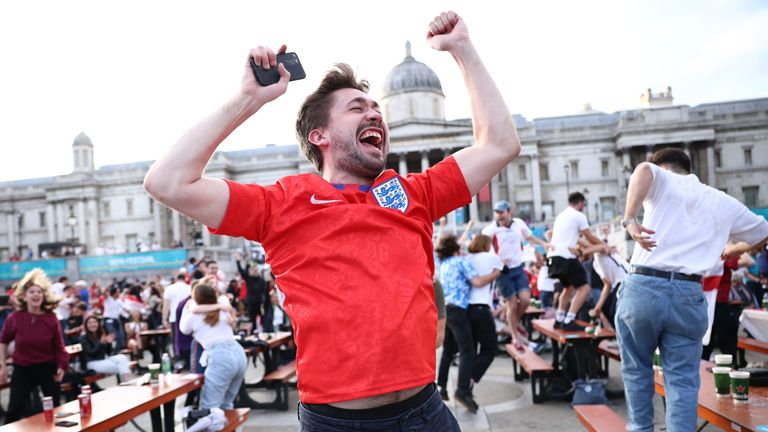Soccer Football - Euro 2020 - Fans gather in London ahead of Ukraine v England - London, Britain - July 3, 2021 England fans in Trafalgar Square celebrate scoring their first goal REUTERS/Henry Nicholls