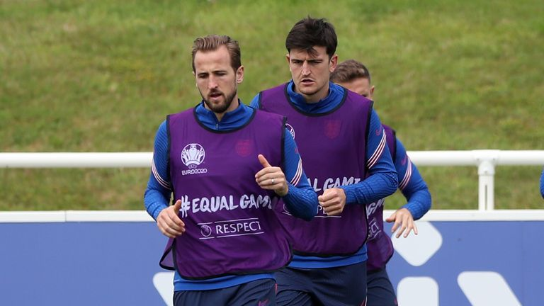 Harry Kane (l) and Harry Maguire during a training session on the eve of the final