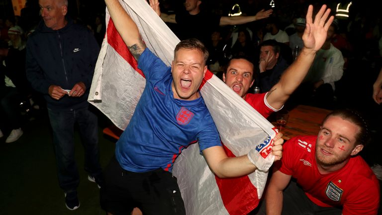 Fans at the Vinegar Yard in London watch the Euro 2020 semi final match between England and Denmark. Picture date: Wednesday July 7, 2021.