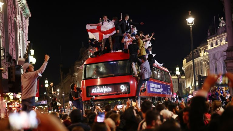 Fans in Piccadilly Circus climbed on a bus in celebration after final whistle