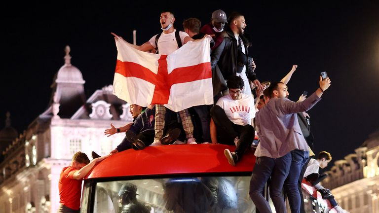 Fans climbed on a bus in Piccadilly Circus
