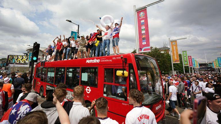 England fans climb aboard a bus outside Wembley Stadium