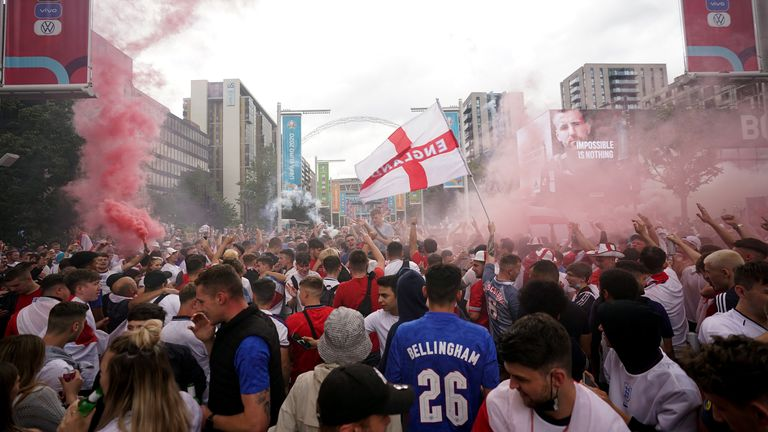Fans let off flares outside Wembley Stadium on Sunday afternoon