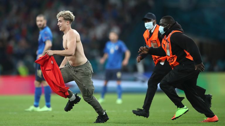 A pitch invader was chased off the field by four stewards near just before full-time