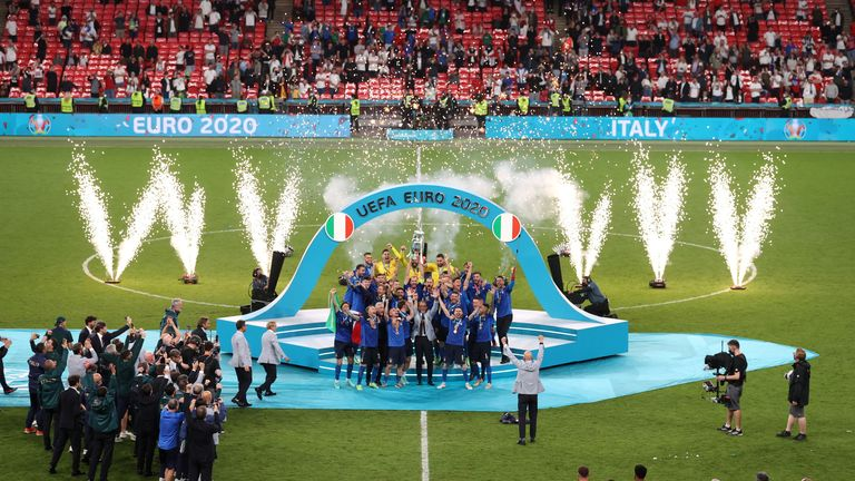 Italy celebrate with the trophy after winning the final of Euro 2020 at Wembley