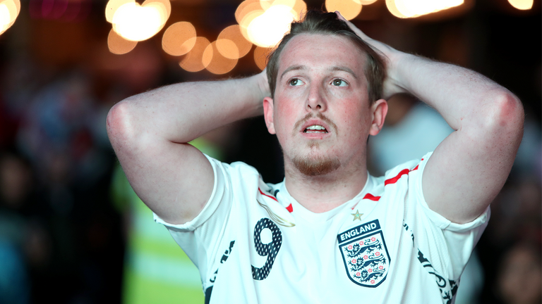 England fans react at the Vinegar Yard in London as they watch the Euro 2020 semi final match between England and Denmark. Picture date: Wednesday July 7, 2021.
