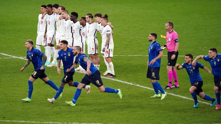 England players look on during the shoot out following the UEFA Euro 2020 Final at Wembley Stadium, London. Picture date: Sunday July 11, 2021.
