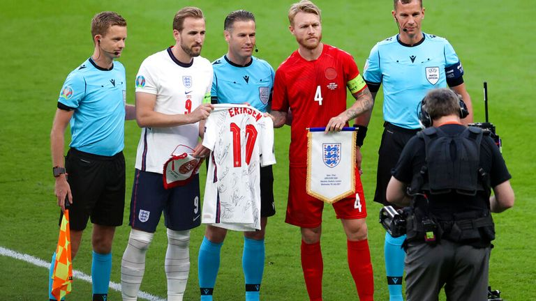 Kane handed Denmark's Simon Kjaer a shirt with Christian Eriksen's name on before the match