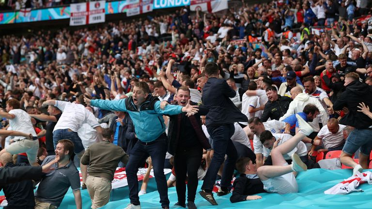 Soccer Football - Euro 2020 - Round of 16 - England v Germany - Wembley Stadium, London, Britain - June 29, 2021 England fans celebrate their first goal scored by Raheem Sterling Pool via REUTERS/Carl Recine TPX IMAGES OF THE DAY