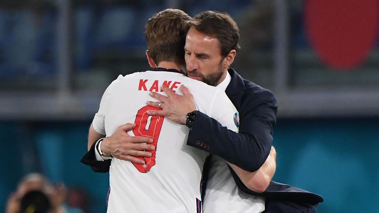 Gareth Southgate hugs Harry Kane after his two goals helped England secure a place in the Euro 2020 semi-finals