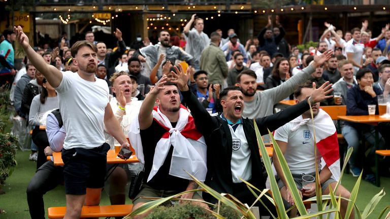 Fans watch the UEFA Euro 2020 round of 16 match between England and Germany at the Vinegar Yard pub
