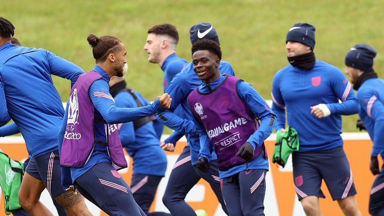 England's Bukayo Saka and Dominic Calvert-Lewin with teammates during training