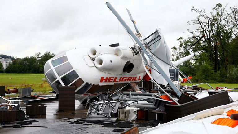 A decommissioned Mil Mi-8 helicopter used as Heligrill snack bar is seen overthrown after thunderstorms and torrential rain, at a plane spotter lookout near Zurich Airport, in Ruemlang, Switzerland July 13, 2021. REUTERS/Arnd Wiegmann