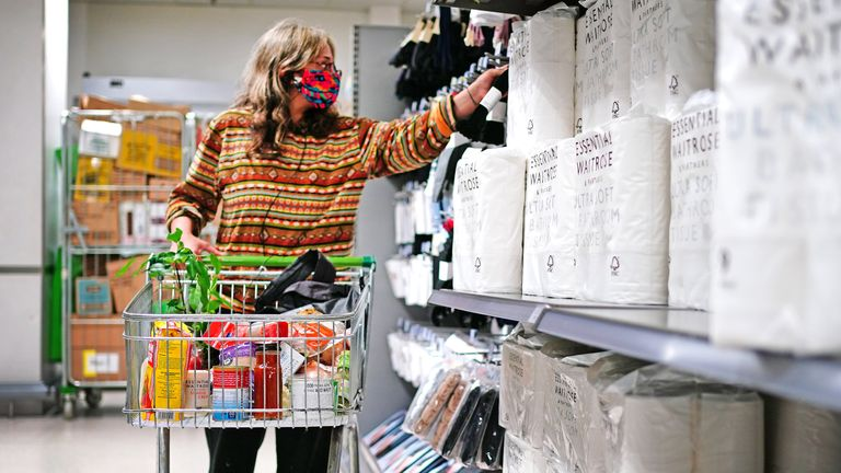 A woman wears a mask during a trip to the supermarket