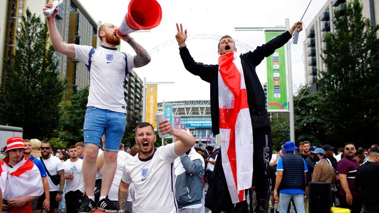 Football fans arrive at Wembley ahead of the final against Italy