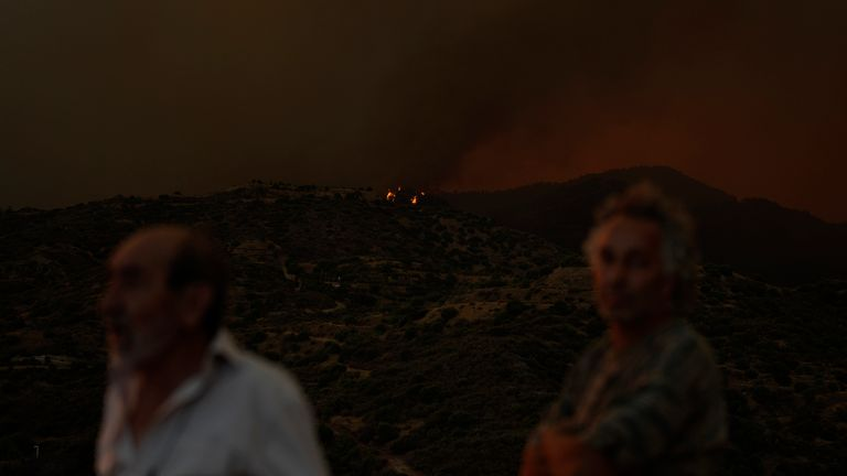 A view of a fire in the Larnaca mountain region on Saturday, July 3, 2021. Cyprus has asked fellow European Union member states on Saturday to help battle a huge fire in a mountainous region of the east Mediterranean island nation that has forced the evacuation of at least three villages. (AP Photo/Petros Karadjias)