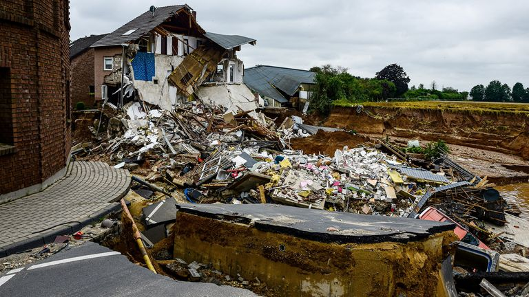 A destroyed road is pictured after flooding in Erftstadt Blessem, Germany