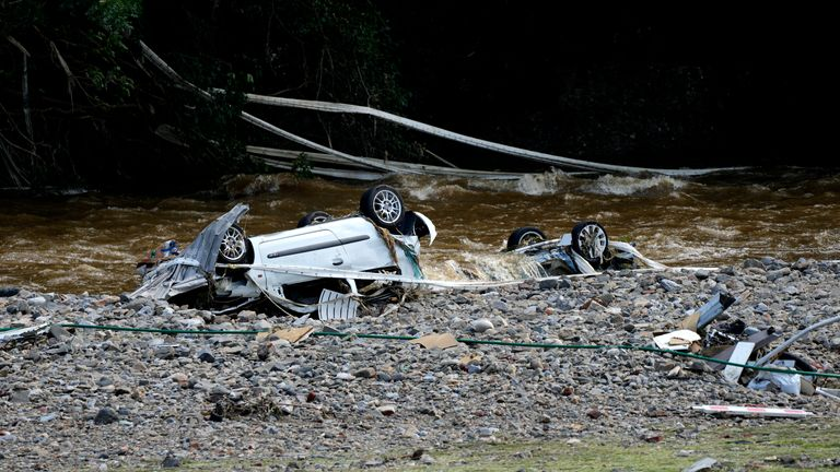 Two cars sit upside down in the Meuse River after flooding in Drolenvol, Belgium, Saturday, July 17, 2021. Residents in several provinces were cleaning up after severe flooding in Germany and Belgium turned streams and streets into raging torrents that swept away cars and caused houses to collapse. (AP Photo/Virginia Mayo)