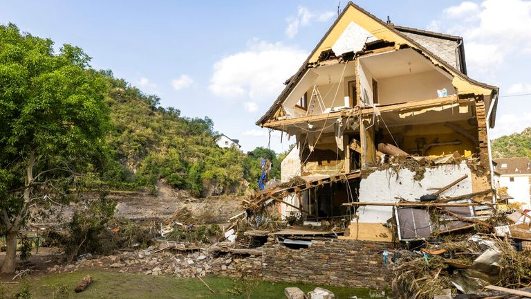 A partially collapsed house stands near the banks of the Ahr river in Altenahr