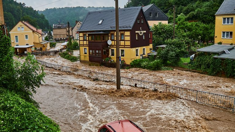 Fast-flowing floodwater runs through the streets amid heavy rainfall in Bad Schandau, Saxon Switzerland, Saxony, Germany July 17, 2021 in this picture taken July 17, 2021 obtained from social media. TWITTER @FORSTIVAAS/via REUTERS THIS IMAGE HAS BEEN SUPPLIED BY A THIRD PARTY. MANDATORY CREDIT. NO RESALES. NO ARCHIVES