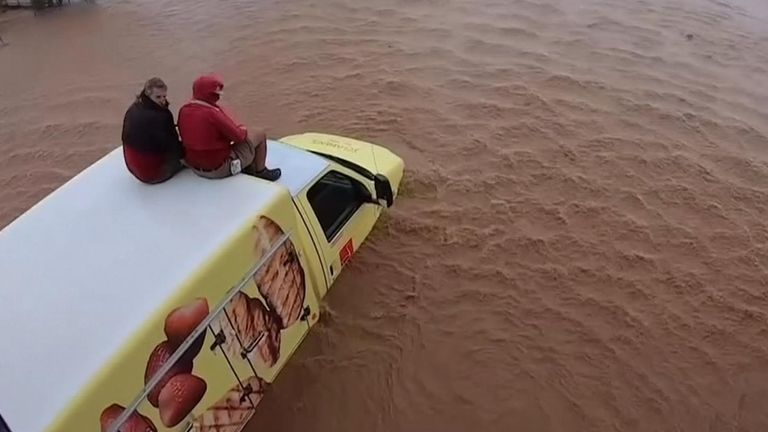 Maricopa County Sheriff's Office aviation unit rescue a driver and his companion after their vehicle got stuck in floodwaters in Arizona.