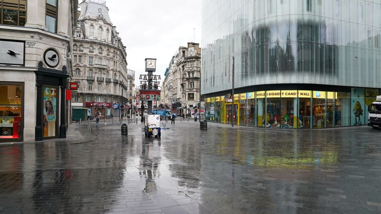 Nice and clean: Leicester Square looked pristine before 8am on Monday after an overnight clean-up
