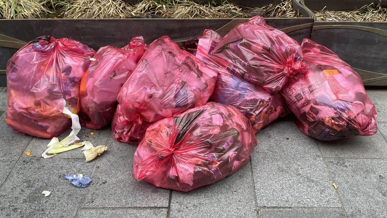 Bags of litter stacked on the side of the road in Leicester Square the morning after England beat Denmark to reach the final of Euro 2020. Picture date: Thursday July 8, 2021.