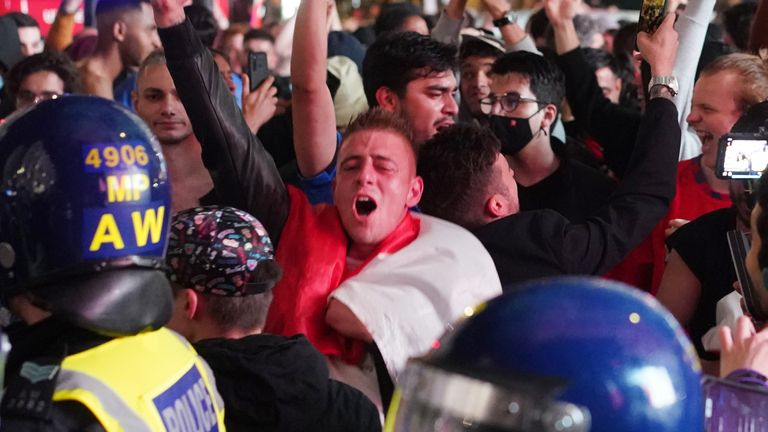 Police and fans in London's Piccadilly Circus after Italy won the UEFA Euro 2020 Final against England