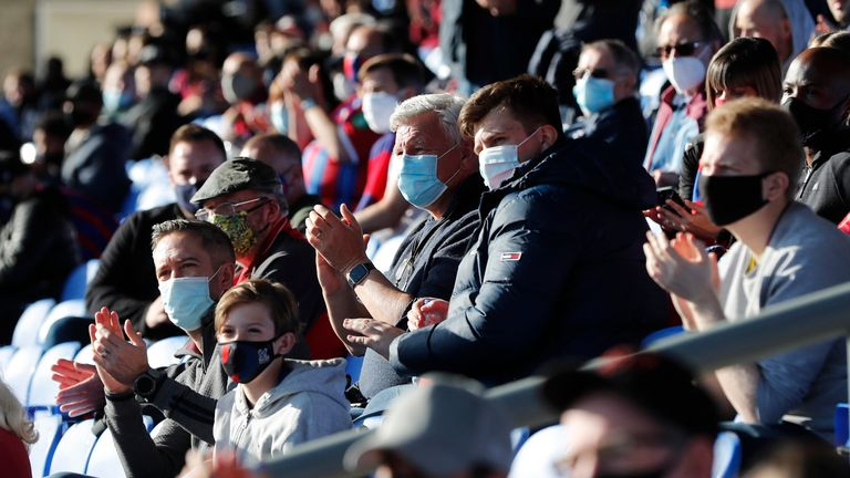 Soccer Football - Premier League - Crystal Palace v Arsenal - Selhurst Park, London, Britain - May 19, 2021 Crystal Palace fans wearing a protective face mask are seen in the stands before the match, as a limited number of fans are permitted at outdoor sports venues Pool via REUTERS/Frank Augstein EDITORIAL USE ONLY. No use with unauthorized audio, video, data, fixture lists, club/league logos or 'live' services. Online in-match use limited to 75 images, no video emulation. No use in betting, ga