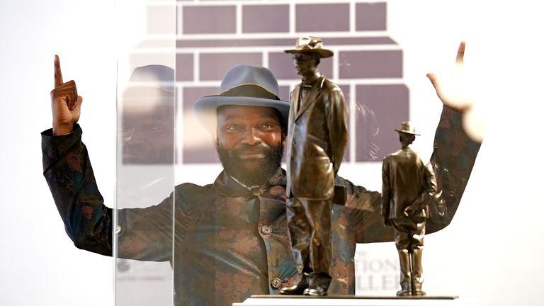 Samson Kambala's piece restages a 1914 photograph of Baptist preacher John Chilembwe and European missionary John Chroley