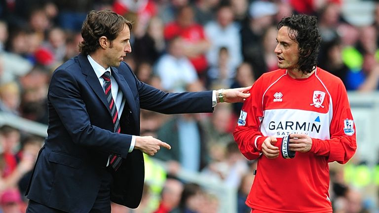 Middlesbrough manager Southgate (L) talks with Tuncay Sanli (R)