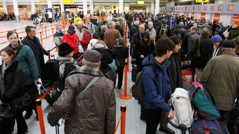 Passengers queue at check-in desks at Gatwick Airport