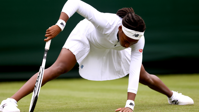 Coco Gauff slips over on the grass during her first round ladies' singles match against Francesca Jones on court 2 on day two of Wimbledon at The All England Lawn Tennis and Croquet Club, Wimbledon. Picture date: Tuesday June 29, 2021.