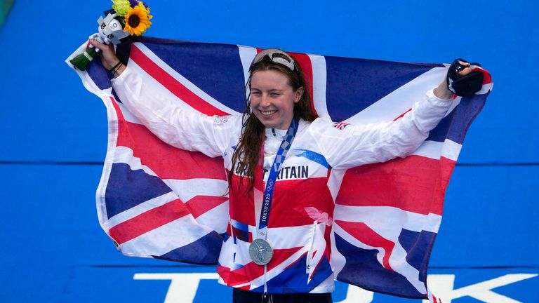Silver medalist Georgia Taylor-Brown of Great Britain celebrates during a medal ceremony during the women's individual triathlon competition at the 2020 Summer Olympics, Tuesday, July 27, 2021, in Tokyo, Japan. (AP Photo/Charlie Riedel)