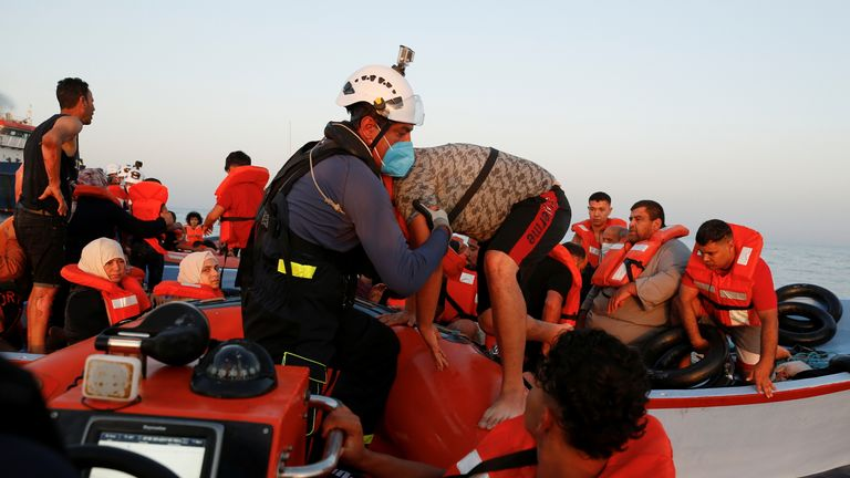 A migrant boards a rigid-hull inflatable boat (RHIB) during a rescue operation by the German NGO migrant rescue ship Sea-Watch 3 in international waters off the coast of Libya, in the western Mediterranean Sea, July 30, 2021. REUTERS/Darrin Zammit Lupi