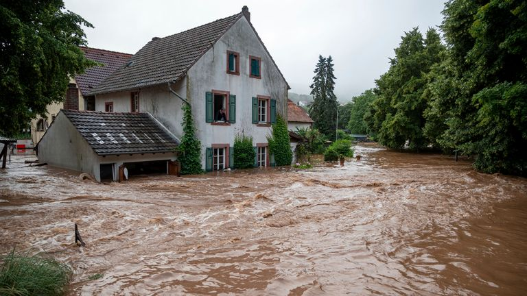 Houses are submerged on the overflowed river banks in Erdorf, Germany. Pic: Harald Tittel/dpa/AP