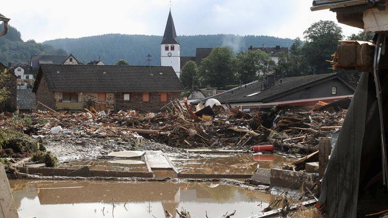 Collapsed houses are seen on a flood-affected area following heavy rainfalls in Schuld, Germany, on July 15, 2021. REUTERS/Wolfgang Rattay