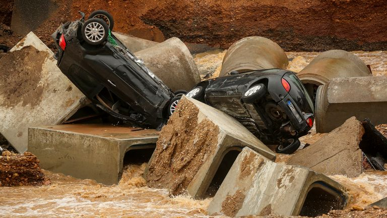 Cars lie in a washed out part of the Bessem district of Erftstadt, Germany. Pic: David Young/dpa/AP