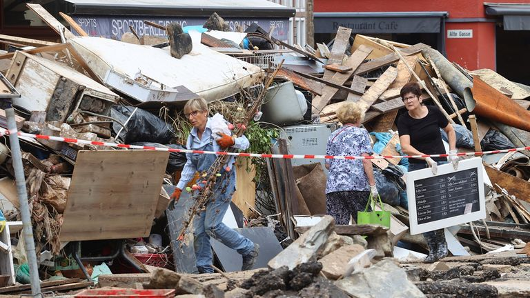 Streets are pictured littered with damaged goods and rubble after floods in Germany