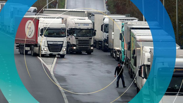 A lorry driver views the queue of lorries on the M20 as lorries wait to enter the Eurotunnel site in Folkestone, Kent, due to heavy freight traffic.