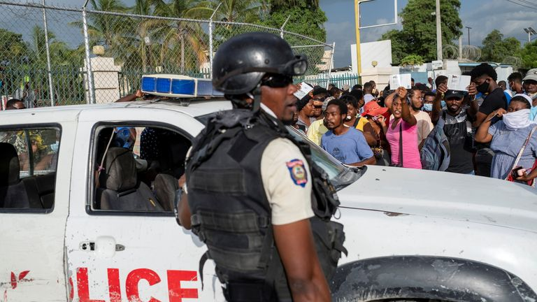 Police in Haiti patrol the streets amid a state of emergency