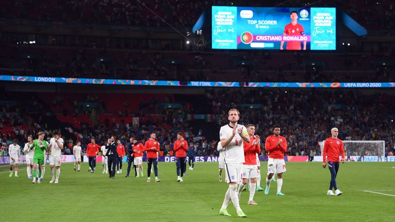 Harry Kane and the England players applaud the fans after the Euro 2020 final
