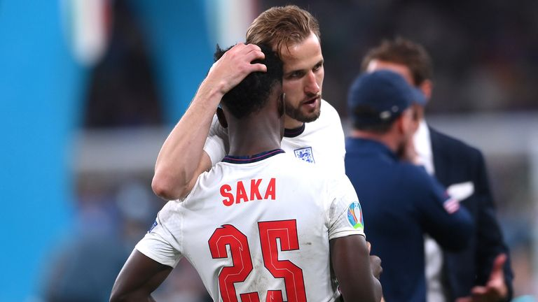 Soccer Football - Euro 2020 - Final - Italy v England - Wembley Stadium, London, Britain - July 11, 2021 England's Harry Kane with Bukayo Saka after the match Pool via REUTERS/Laurence Griffiths