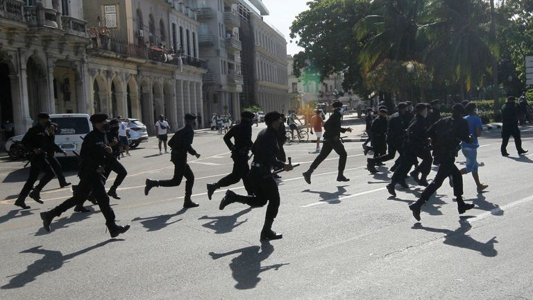 Police run during the protests