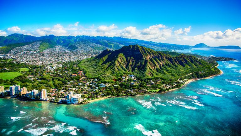 The dormant volcano known as Diamond Head located adjacent to downtown Honlulu, Hawaii, as shot from an altitude of about 1500 feet over the Pacific Ocean.
