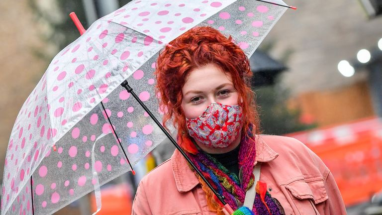 A  woman wearing a face mask in the centre of Cardiff