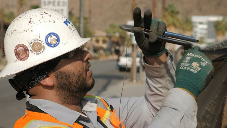 Construction worker Carlos Moreno has shifted his hours to starting earlier in the day and even altered his diet to cope with the heat in Palm Springs, California